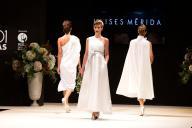 runway of white wedding dresses