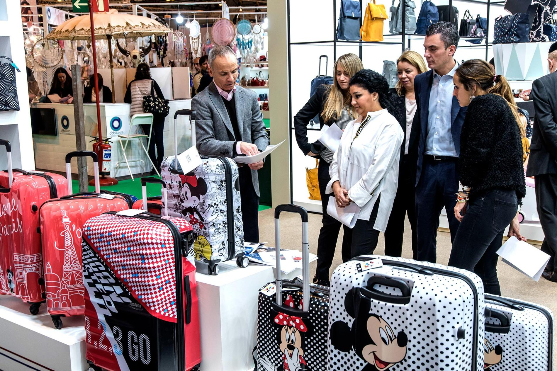 exhibitor explaining travel suitcases