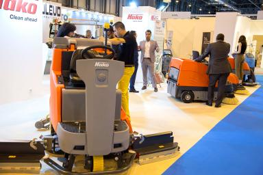 Professionals meeting at the cleaning machines stand