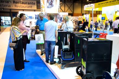 Visitors on stand looking at cleaning products