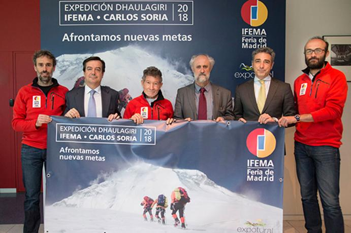 The mountaineer Carlos Soria together with sponsors of the expedition