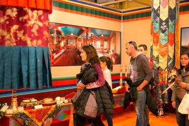 Visitors to the fair admiring a Tibetan stand