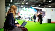 Woman consulting her laptop during the fair