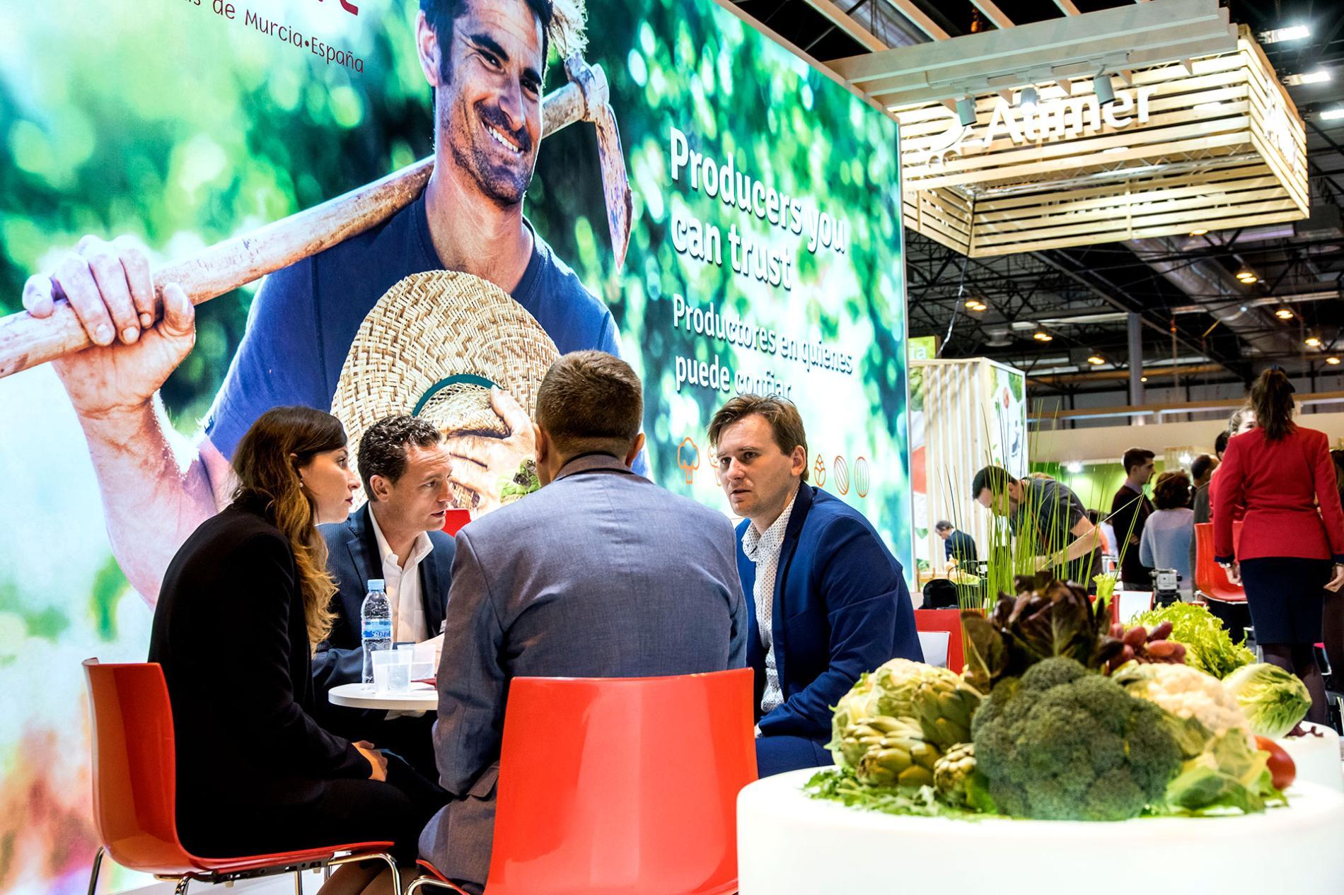 exhibitor explaining to visitors