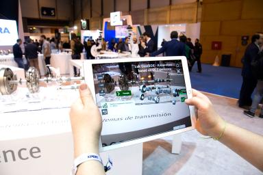 Hands holding a tablet with an application for the engine