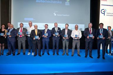 Representatives of motor companies collecting an award