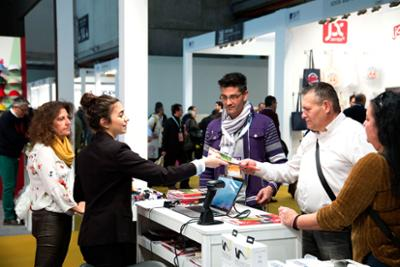 Exhibitor giving a brochure to a visitor