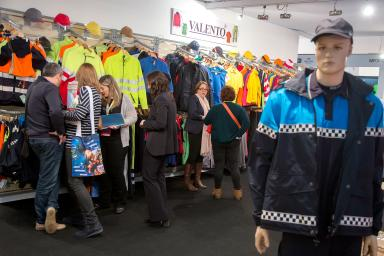 Visitors in front of promotional and work clothes