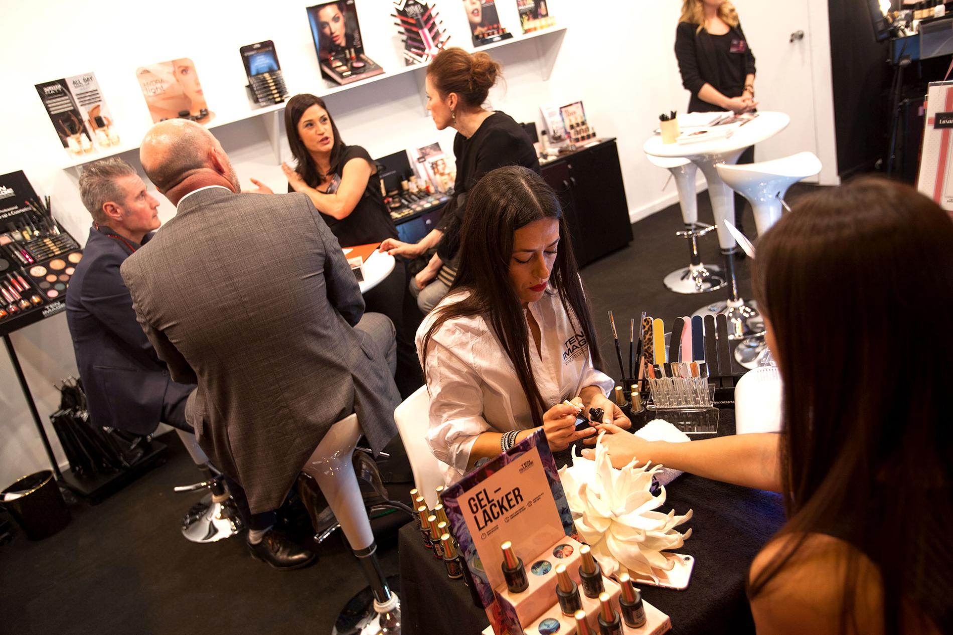 exhibitor painting nails to visitor