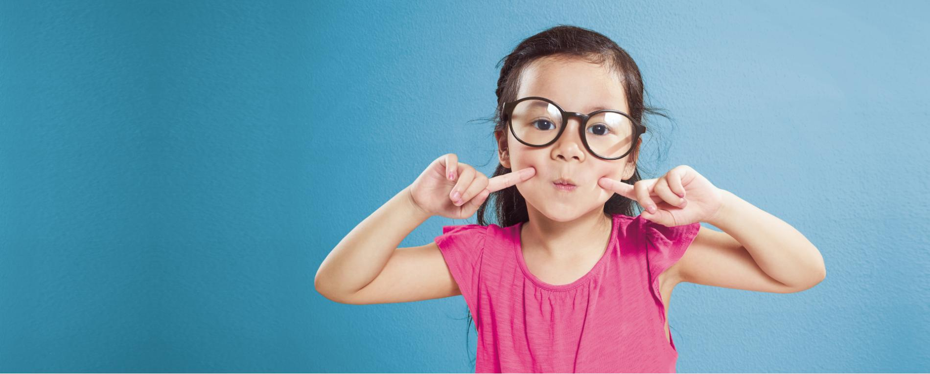 girl with glasses making faces