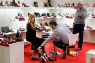Visitor trying on a shoe in Shoesroom by MOMAD