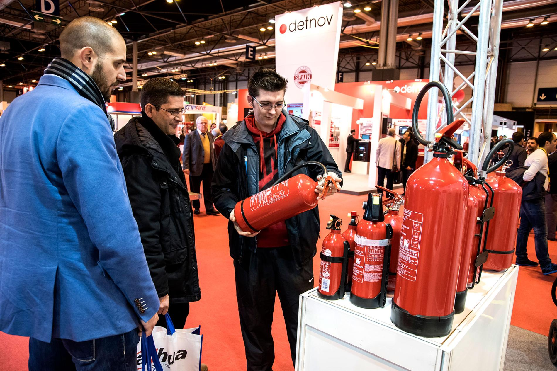 Assistants with fire extinguishers at the Sicur fair