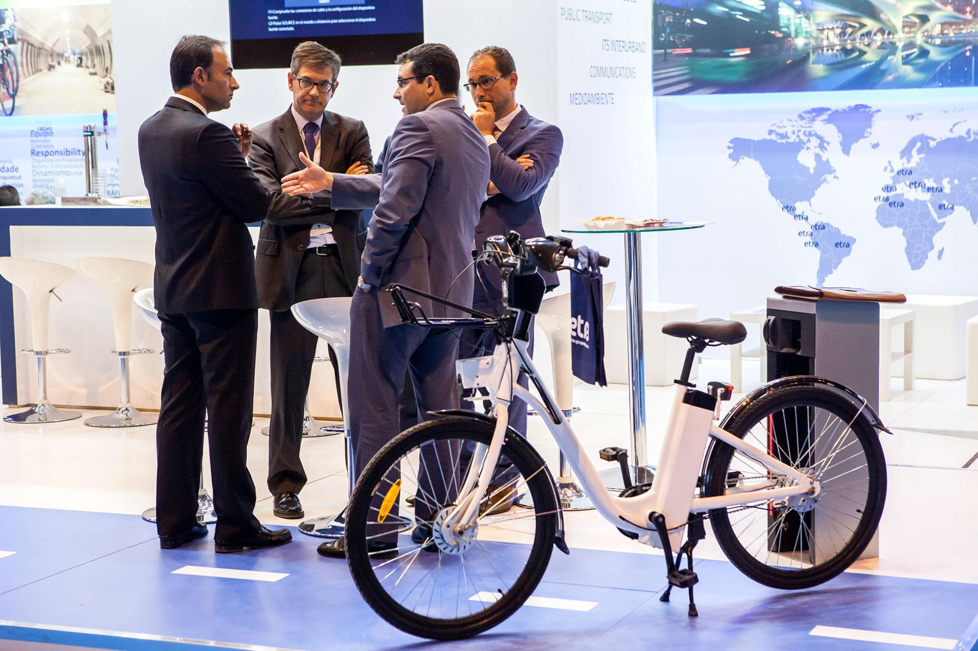 Professionals of the sector next to an electric bicycle